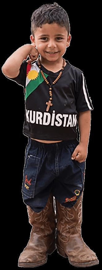 Kurdish Arab boy wearing cowboy boots