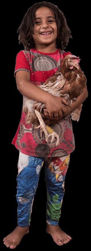 Iraqi girl carrying a chicken