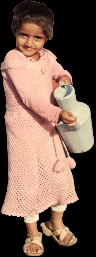Iraqi girl carrying a water jar